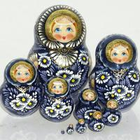 Blue matryoshka with chamomile