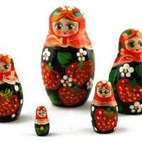 Nesting dolls with strawberries