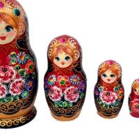 Ξύλινες κόκκινες κούκλες matryoshka με λουλούδια