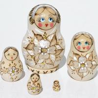 Nesting wooden doll