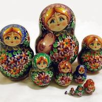 Wooden dolls with flowers